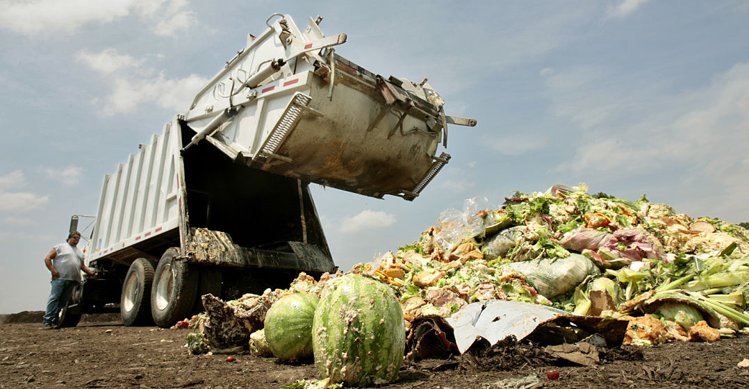Driver Aaron Cornine lowers the back of the truck after dumping his load of food and compostable waste at Missouri Organic's Liberty facility, July 9, 2009. Much of it is covered in dough from baked goods.  (Photo by Jill Toyoshiba/Kansas City Star/MCT via Getty Images)